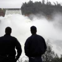 California dam woes laid to 'patch and pray' crack repair as workers rush to drain reservoir before storms