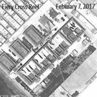 A satellite image shows what CSIS Asia Maritime Transparency Initiative says appears to be concrete structures with retractable roofs on the artificial island Fiery Cross Reef in the South China Sea in this image released Wednesday. | CSIS/AMTI/DIGITALGLOBE