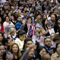 Thousands become U.S. citizens in Los Angeles ceremony