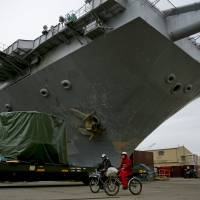 U.S. Navy decommissions 'legendary' first nuclear-powered carrier