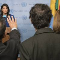U.S. Ambassador to the United Nations Nikki Haley speaks to reporters after a Security Council meeting on the situation in the Middle East Thursday at U.N. headquarters. The United Nations and the Arab League on Thursday issued a joint statement in support of the establishment of a Palestinian state. | AP