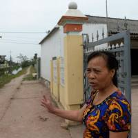 Nguyen Thi Vy, 54, mother-in-law of Doan Thi Huong, a suspect in the assassination of Kim Jong Nam, stands at the family home in Nghia Hung, Vietnam, on Wednesday. | AFP-JIJI