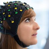 The NIRS/EEG brain-computer interface system is worn by a model in Switzerland in this undated photograph released in London Tuesday, | LAURENT BOUVIER / WYSS CENTRE / HANDOUT VIA REUTERS