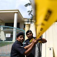 Malaysian police cordon off the area outside the North Korean Embassy in Kuala Lumpur on February 23, 2017 ahead of a protest by the United Malays National Organization (UMNO) Youth activists. Malaysian detectives probing the assassination of Kim Jong Nam admitted on Thursday that they cannot force a wanted North Korean diplomat to answer their questions. Police later revealed they found traces of the nerve agent VX on the slain Kim's face.   AFP-JIJI