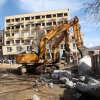 Serb-built wall in Kosovo city pulled down without incident after EU, U.S. mediate