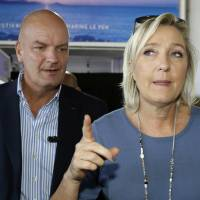 Le Pen blasts 'campaigning hysterically' media as Macron jumps in French polls