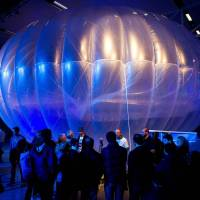 Visitors view a Project Loon high-altitude internet hub, on display at the Airforce Museum in Christchurch, New Zealand, in June 2013. | AFP-JIJI