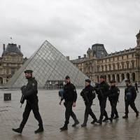 Machete-wielding attacker at Louvre Museum shot and wounded by soldier