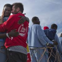 Italy rescues 1,500 migrants at sea in two days despite winter, EU accord to curb traffickers