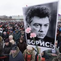 Thousands march in Moscow to honor opposition leader slain outside Kremlin