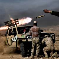 Iraqi forces battling Islamic State reach key Mosul bridge as casualties mount
