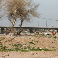A bridge near the al-Josaq district in western Mosul, Iraq, is seen Monday. | REUTERS