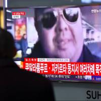 A man watches a television showing news reports of Kim Jong Nam, the half-brother of North Korean leader Kim Jong Un, in Seoul on Tuesday. Kim Jong Nam has been assassinated in Malaysia, South Korean media reported Tuesday. | AFP-JIJI