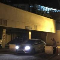 A police car leaves the morgue at Putrajaya hospital in Malaysia Tuesday. | REUTERS