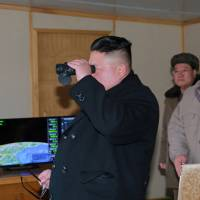 North Korean leader Kim Jong Un guides the test-firing of the Pukguksong-2 missile in this undated photo released Monday. | REUTERS