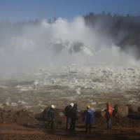 Water is released from the Lake Oroville Dam after an evacuation was ordered for communities downstream from the dam in Oroville, California, Tuesday. | REUTERS