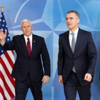 Pence tries to reassure wary EU, NATO of U.S. support, says Flynn disappointed him