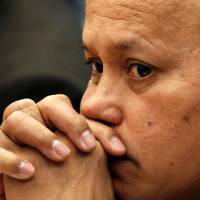 Philippine National Police chief Gen. Ronald dela Rosa listens to a policeman's testimony in Manila, on Jan. 26 during a senate investigation into the death of South Korean businessman Jee Ick-joo. | REUTERS