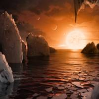 An artist's depiction shows the possible surface of TRAPPIST-1f, on one of seven newly discovered planets in the TRAPPIST-1 system that scientists using the Spitzer Space Telescope and ground-based telescopes have discovered, according to NASA, in this illustration released Wednesday. | COURTESY NASA / JPL-CALTECH / HANDOUT / VIA REUTERS