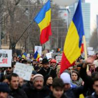 Mass protests force Romania government climb-down
