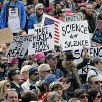Members of the scientific community, environmental advocates and supporters demonstrate Sunday in Boston to call attention to what they say are the increasing threats to science and scientific research under the administration of President Donald Trump. | AP
