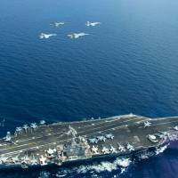 In first official comments, Beijing voices displeasure with U.S. carrier patrols in South China Sea