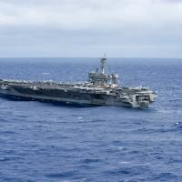 The aircraft carrier USS Carl Vinson transits the Philippine Sea on Wednesday, heading toward the South China Sea for 'routine operations' that started Saturday.   U.S. NAVY