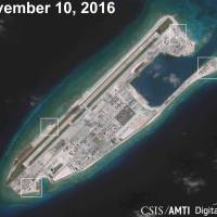 A satellite image shows what appears to be anti-aircraft guns and what are likely to be close-in weapons systems on the artificial island at Fiery Cross Reef in the South China Sea in this image released Dec. 13. | CSIS ASIA MARITIME TRANSPARENCY INITIATIVE / DIGITALGLOBE / VIA REUTERS