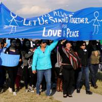 Hundreds attend vigil in Kansas City suburb following shooting death of Indian engineer
