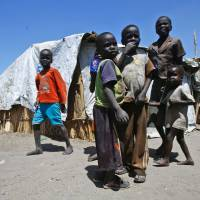 Starving South Sudanese refugees swarm border transit camp after ordeal living off leaves