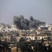 130 found shot, beheaded in Syria mass graves