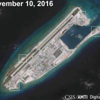 A satellite image shows what appear to be anti-aircraft guns and close-in weapons systems on the artificial island Fiery Cross Reef in the South China Sea in this image released on Dec. 13. | REUTERS