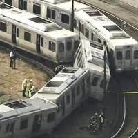 Four hurt when deadheading subway train rear-ends stopped traffic in Philly yard