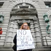 Beth Kohn protests over U.S. President Donald Trump's executive order travel ban, outside the 9th U.S. Circuit Court of Appeals courthouse in San Francisco Tuesday. | REUTERS