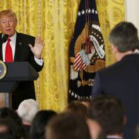 U.S. President Donald Trump takes a question from CNN reporter Jim Acosta during a news conference at the White House in Washington Thursday.   REUTERS