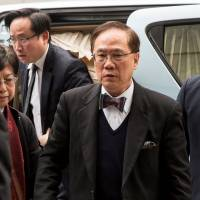 Ex-Hong Kong chief gets 20 months in jail for misconduct
