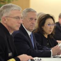 U.S. Defense Secretary James Mattis (center) chats with Foreign Minister Fumio Kishida at the Foreign Ministry on Friday. | AP