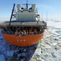 A team conducts research aboard the Shirase icebreaker in Lutzow-Holm Bay, Antarctica, on Jan. 22, in this image taken from a drone. | KYODO