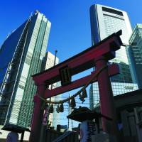 Skyscrapers in the Shiodome district in Minato Ward, Tokyo, tower over 400-year-old Hibiya Shrine on Feb. 20. | SATOKO KAWASAKI