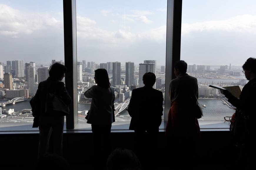 Visitors view Tokyo Bay, including the Harumi and Odaiba waterfront districts, from an observatory about 200 meters above street level Feb. 20 in Minato Ward, Tokyo.