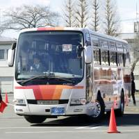 Bus drivers test safety skills in Tokyo competition