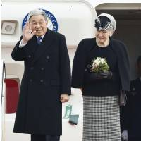 Emperor Akihito waves as Empress Michiko stands beside him before the Imperial Couple left for Vietnam on Tuesday.   KYODO