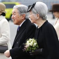 Emperor Akihito and Empress Michiko are seen at Haneda airport in Tokyo on Tuesday morning before they left for Vietnam. | AP