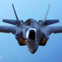 A U.S.Marine Corps F-35B joint strike fighter jet conducts maneuvers during aerial refueling training over the Atlantic Ocean in this undated picture released in 2015. | U.S. MARINE CORPS / HANDOUT / VIA REUTERS