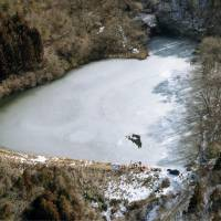 This aerial photo taken Tuesday shows the pond in Iwate Prefecture where the bodies of four men from the city of Oshu were found after going on an ice fishing trip. | KYODO