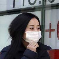 Schools close, hospitals swell as influenza spikes