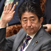 Fear of losing Trump on trade and defense lies behind Abe's silence over 'Muslim ban'