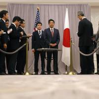 Prime Minister Shinzo Abe talks to the media after his first meeting with then U.S. President-elect Donald Trump in New York on Nov. 17, 2016. | AP
