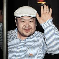 Dressed in jeans and blue suede loafers, Kim Jong Nam, the eldest son of then-North Korean leader Kim Jong Il, waves after his first-ever interview with South Korean media in Macau in June 2010. | AP