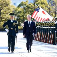 U.S. Defense Secretary James Mattis reviews an honor guard during the welcoming ceremony at the Defense Ministry in Tokyo on Saturday. | AFP-JIJI